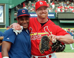 Mark McGwire and Sammy Sosa show off their muscles
